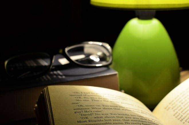 book glasses and lamp